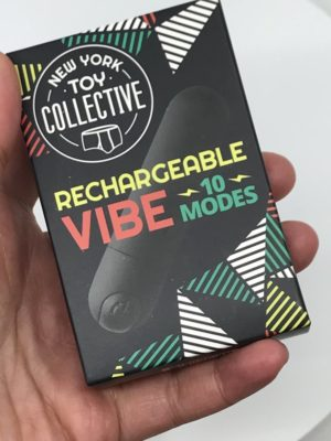 Dark Box with a Black Bullet Vibe Pictured, Text reads Rechargeable Vibe 10 modes by New York Toy Collective