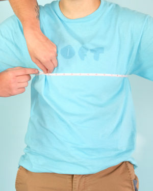 a model in a t-shirt with a tape measure wrapped around the fullest part of the models chest